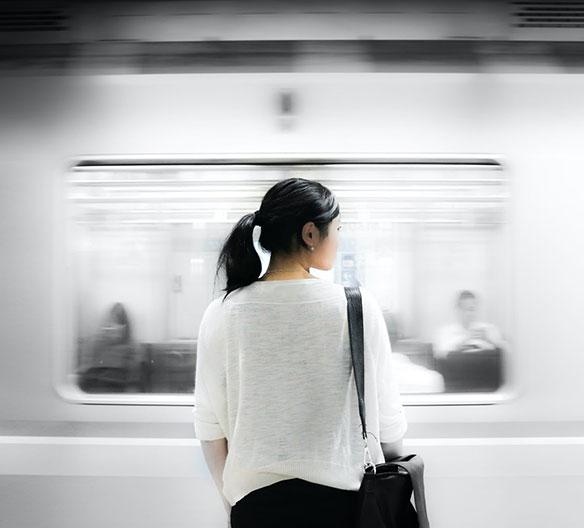 Asian woman outside of a subway