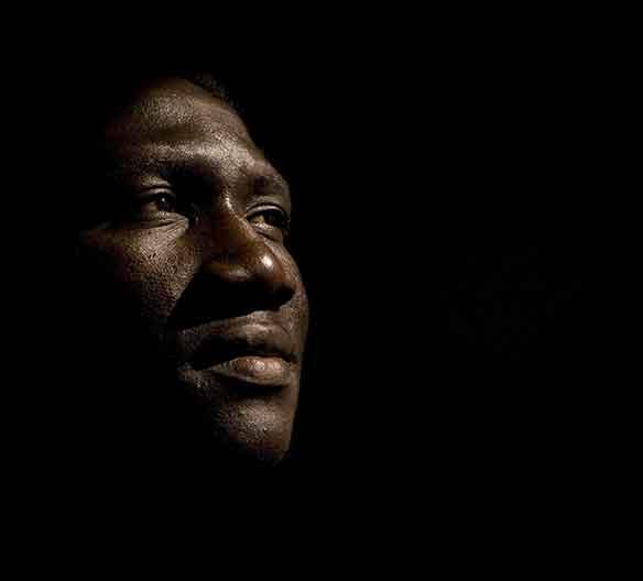 black man's face on black background